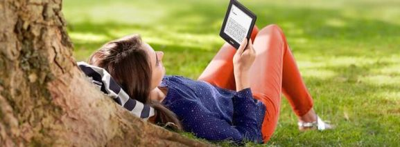 Woman Reading Book on a Kindle