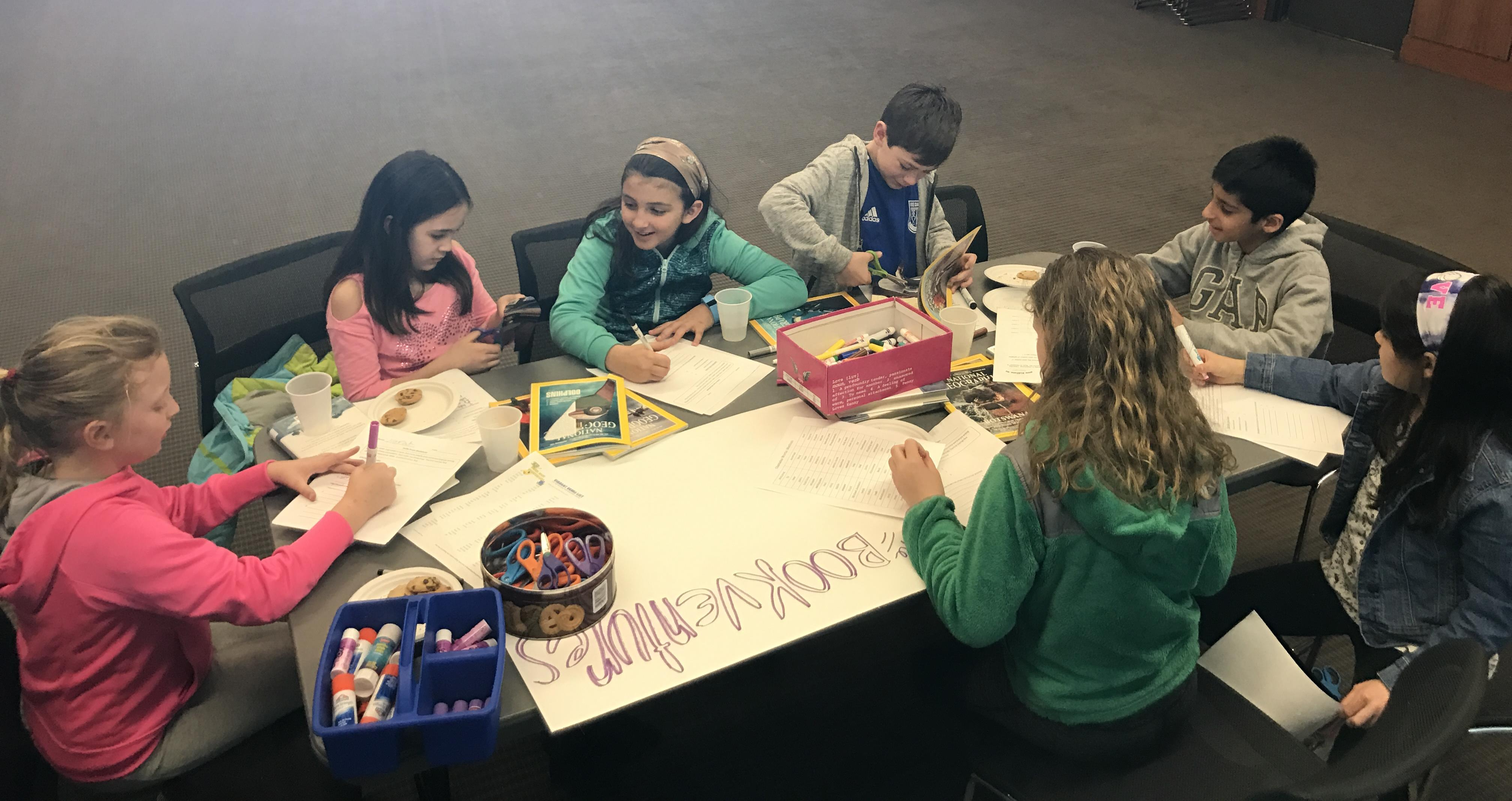 Book club members draw a picture together